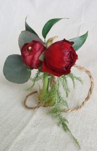 Burgundy ranunculus vase boutonniere