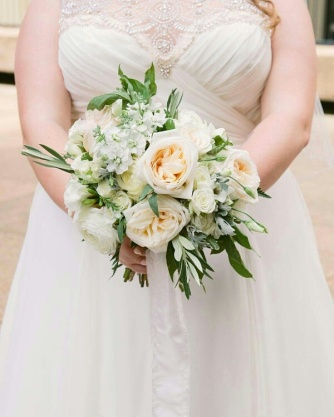 Ivory garden roses with delicate foliage